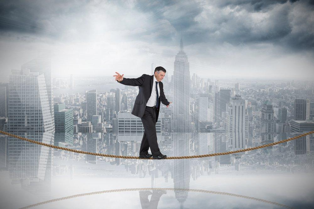 Businessman Balancing Act