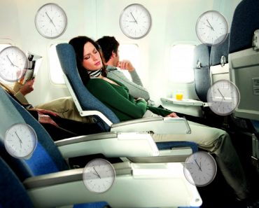 Sleeping woman airplane passenger Jet lag