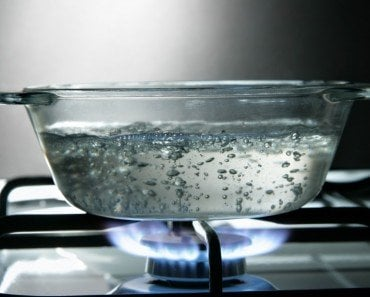 Boiling water in glass saucepan