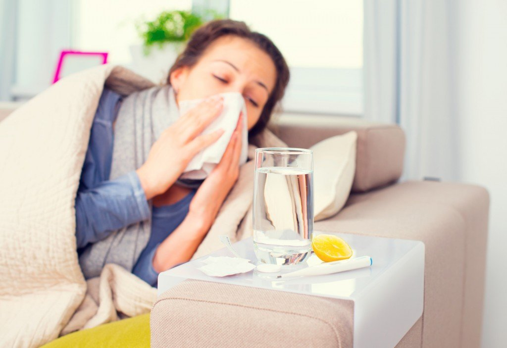 Sneezing and Sick (Photo Credit: Subbotina Anna / Fotolia)