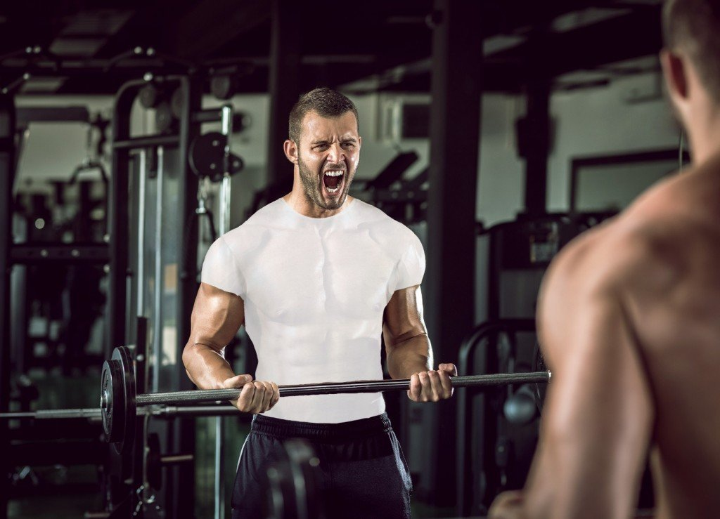 Man grunting in gym