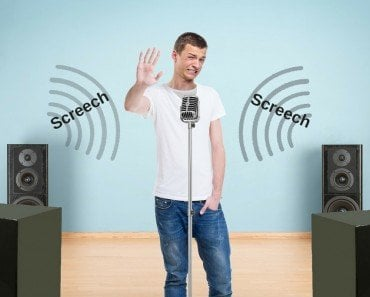 Why Do Mics Sometimes Make A Squealing Sound When You Speak Into Them?