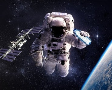 Astronaut & water bottle in space