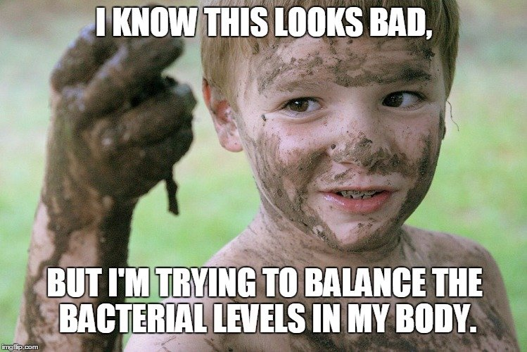 Child playing in mud meme