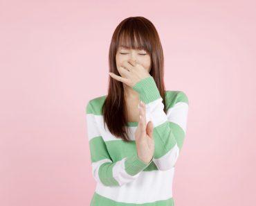 Girl pinching her nose