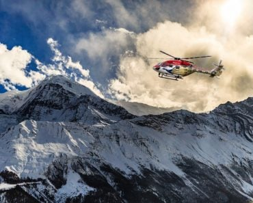 Helicopter landing on a mountain