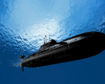 The military ship in the sea submarine