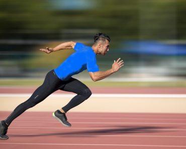 Sprinter leaving on the running track. Explosive start. speed