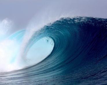 Tropical blue surfing wave ocean sea