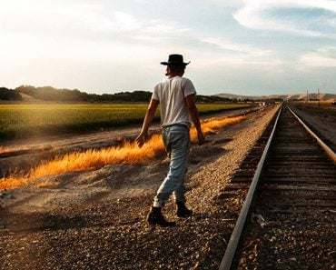 Man walking near railway track