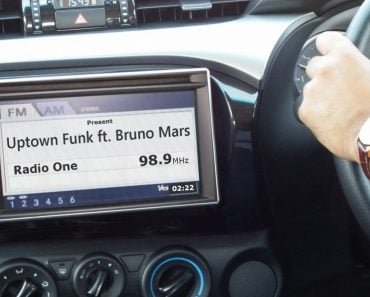 Car radio showing song name