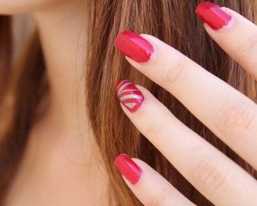 Hand red nail polish