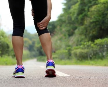 young fitness woman jogger hold her sports injured leg at forest trail (lzf)(s)