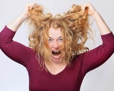 Woman Pulling Out frizz Hair