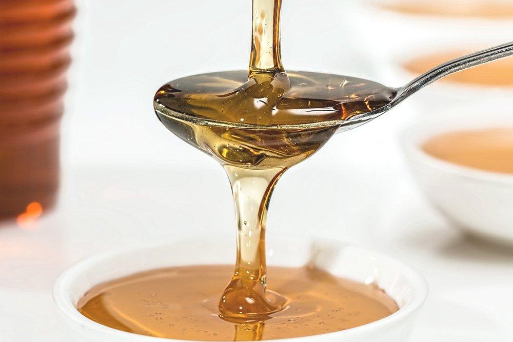 Honey in full spoon