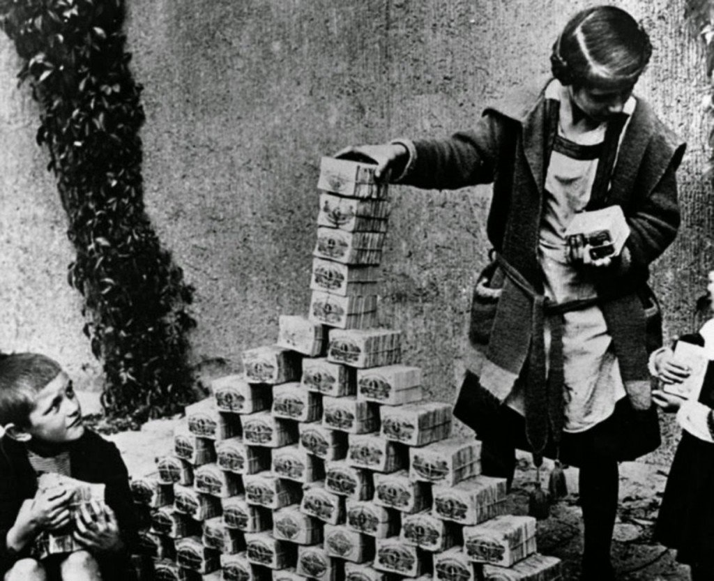 A young girl in Germany playing with what seems to be bundles of money