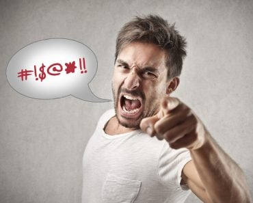Swearing featured image Portrait of a angry young man