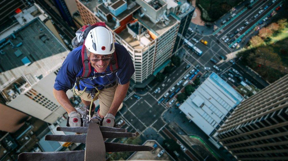 climber climbing on building