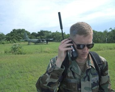 Maj. Jason Clark uses a satellite phone