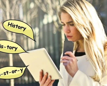 Confused girl reading history word in tablet