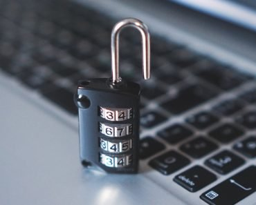 Number lock padlock near laptop