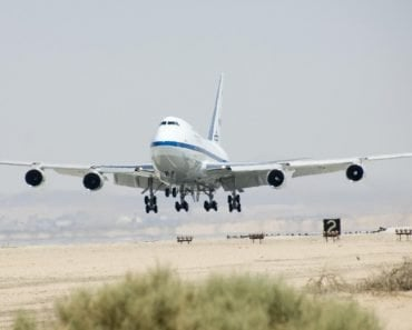 Airplane flying taking off in hot climate