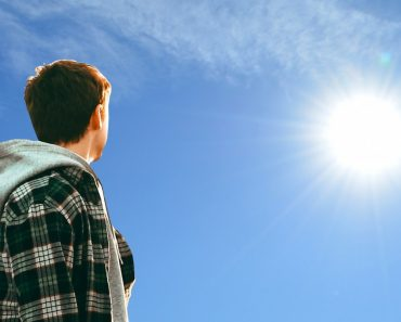 Young man looking at sun