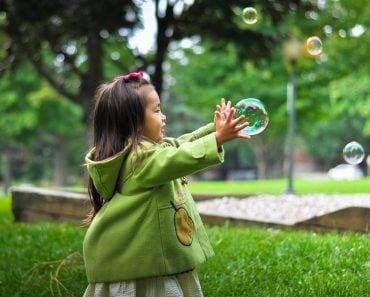 kid child playing bubbles