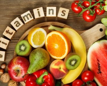 Vitamins in fruits and vegetables. Natural products rich in vitamins as oranges, lemons, red pepper, kiwi, tomatoes, bananas, pears, apples, walnuts, watermelon, hazelnuts, peach and green grape - Image( Evan Lorne)s