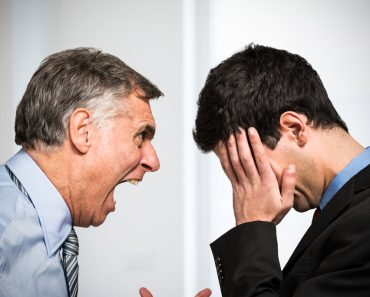 Angry boss shouting to an employee - Image( Minerva Studio)s