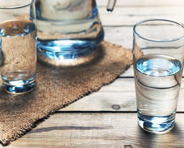 Glasses of water on a wooden table. Selective focus. Shallow DOF - Image( SedovaY)s