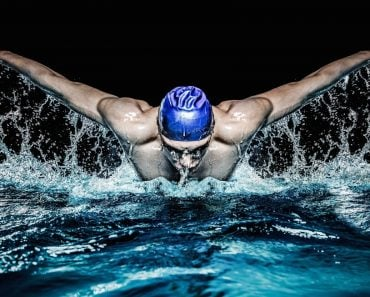 Muscular young man in blue cap in swimming pool - Image( Nejron Photo)s