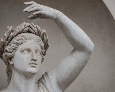 Statue of sensual Roman renaissance era woman in circlet of bay leaves, Potsdam, Germany - Image( Oleg Senkov)