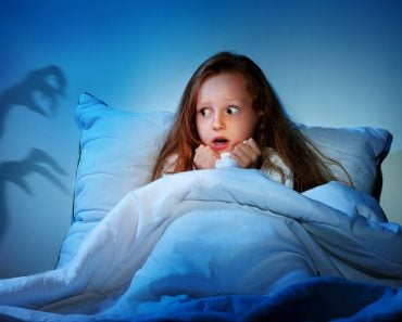 Sleepless girl in her bed having fears of night monsters - Image(Kasefoto)s