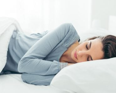 Young beautiful woman sleeping in her bed and relaxing in the morning - Image( Stock-Asso)S