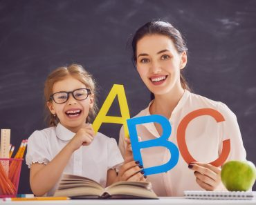 Back to school! Child is learning to write. Adult woman teaches child the alphabet. - Image( Yuganov Konstantin)s