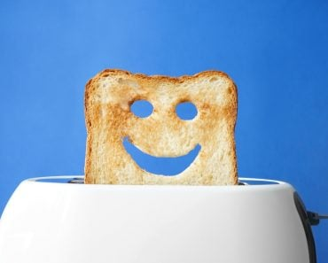 Funny slice of bread with toaster on color background( Pixel-Shot)s