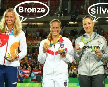 Monica Puig PUR and Angelique Kerber GER during medal ceremony after tennis women's singles final of the Rio 2016 Olympic Games( Leonard Zhukovsky)s