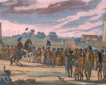 Natives of the colony of British Guiana are reviewed prior to their clean up operations( Everett Historical)s