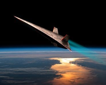 The leading edges of an unmanned scramjet glow from friction as it flys toward outer space near the edge of Earth's atmosphere(Marc Ward)s