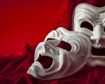 Theatre and opera concept with theatrical masks on red velvet( Victor Moussa)S
