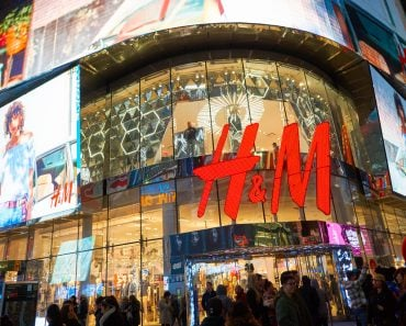 Times Square H&M store at night. H & M Hennes & Mauritz AB is a Swedish multinational retail-clothing company(Sorbis)s