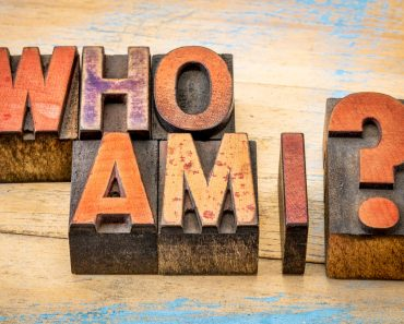Who am I - a philosophical question spelled in vintage letterpress wood type printing blocks against grunge(marekuliasz)s