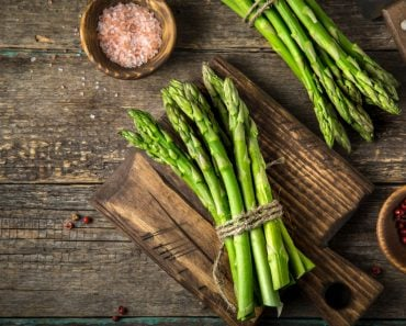 banches of fresh green asparagus on wooden background( Anna Shepulova)S