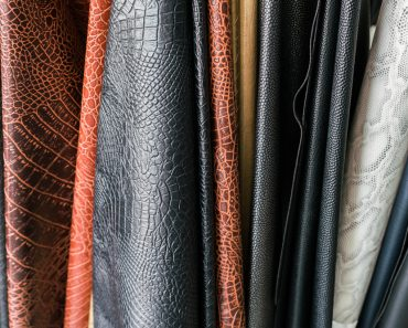 Glitter PU leather in different textures folded in shelf for customer to choose material(TaraPatta)S