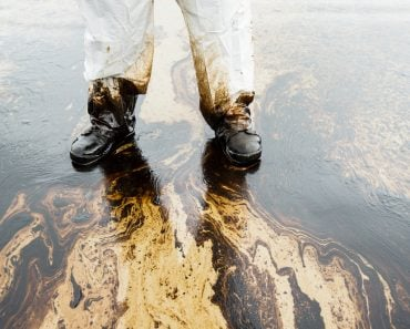 crude oil on oil spill accident on Ao Prao Beach at Samet island( Signature Message)s