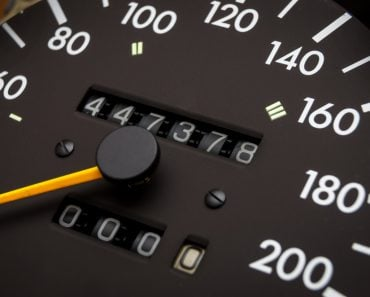 Close up shot of a speedometer in a car. Car dashboard odometer