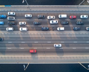 Aerial top view of bridge road automobile traffic of many cars(JaySi)S