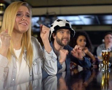 Anxious blond lady sports fan crossing fingers(Motortion Films)s