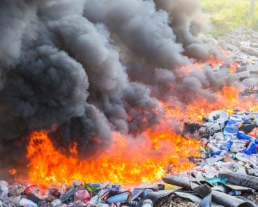Burning garbage heap of smoke from a burning pile of garbage(SmerbyStudio)s